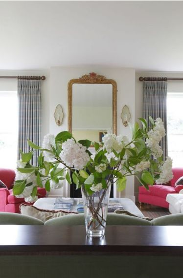 Sitting room | Vase of flowers sits on a table by Adam Williams as you enter the sitting room