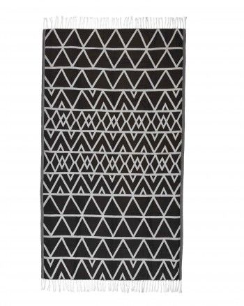 """Lightweight and generously sized, """"Africa"""" is a jacquard weaved """"hammam"""" towel made out of pure cotton. Its reverse colored pattern and fringe detailing creates an elegant accessory which can also be used as beach mat, sarong or cover up. This ultra soft towel is perfect for an everyday use."""