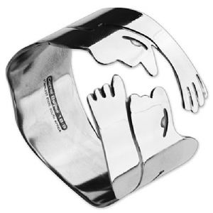 This face design stainless steel napkin ring by South African designer Carrol Boyes is an elegant addition to a dinner table.