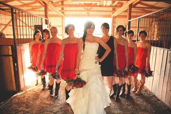 A wedding with real kick! Lovin' the red bridesmaids dresses, black maid of honor .... and the COWBOY BOOTS! oklahoma city wedding photographer - justin battenfield photography LOVE IT IN THE BARN!!!