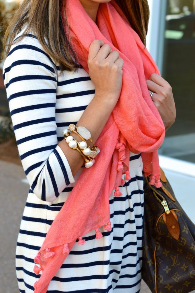 White dress with navy or black stripes, and a salmon scarf. Gorgeous!