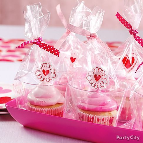 Make pretty take-home cupcake favors with a cute picks plus clear tumblers and party bags tied with fabric ribbon.