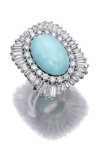 A turquoise and diamond ring, Sabbadini designed as a rectangular plaque, set with baguette and circular-cut diamonds, centering an oval turquoise cabochon, measuring approximately 19.0 x 14.0mm.; signed Sabbadini, with signed box; estimated total diamond weight: 5.30 carats; mounted in eighteen karat white gold.