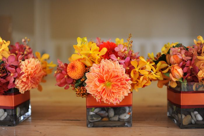 The low centerpieces will be square vases wrapped in bands of navy ribbon filled with orange roses, silver brunia, blush spray roses, light blue hydrangeas, gray dusty miller, orange mokara orchids, and blue thistles surrounded by mercury glass votives.Floral Centerpieces, Orange Wedding, Fall Centerpieces, Fall Table, Wedding Flower, Fall Flower, Fall Arrangements, Fall Wedding, Low Centerpieces Wedding Fall