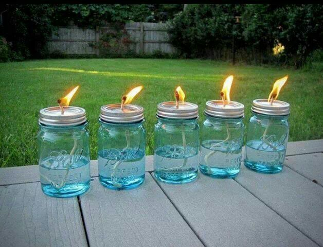 Mason jars + string+liquid citronella and soak strings before lighting....mosquito repellent
