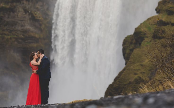 Arjun and Amanda at #skogafoss waterfalls in Iceland www.bigalstudios.ca #seljalandsfoss #seljalandsfossfalls #skogafossfalls #skogafoss #thatreddress #reddressiceland #icelandengagementshoot #icelandphotoshoot #icelandweddingpictures #internationalweddingphotographer #torontoweddingphotographer #destinationweddingphotographer #eshootideas #wowair #bluelagoon #wheniniceland #reykjavik #bigalstudiostoronto