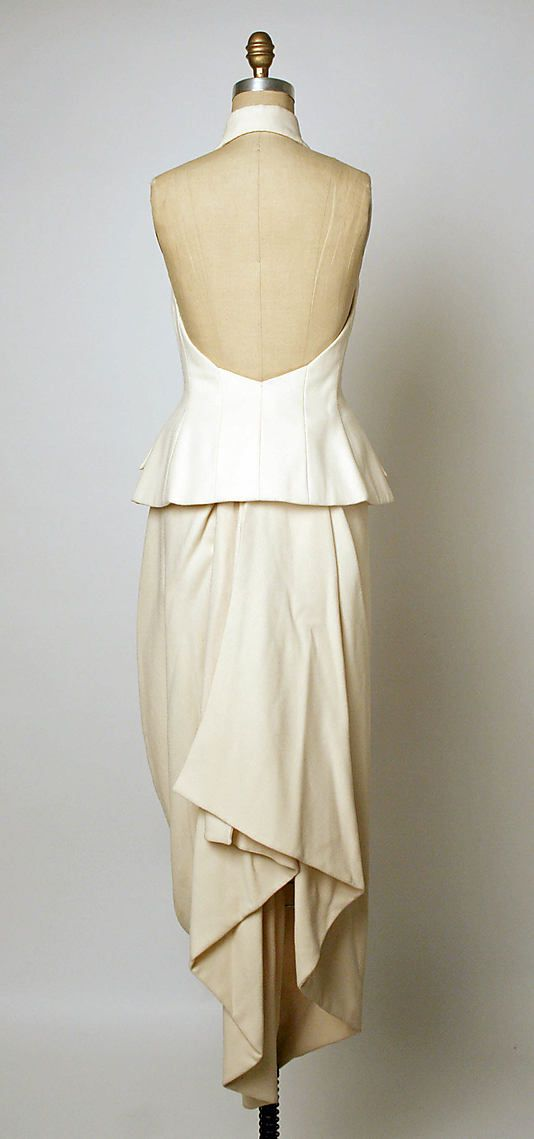 Ensemble, Evening  House of Dior  (French, founded 1947)    Designer:      John Galliano (British, born Gibraltar, 1960)  Couture Line:      House of Dior (French, founded 1947)  Date:      spring/summer 1998  Culture:      French  Medium:      a) wool, silk; b) wool  Dimensions:      N/A  Credit Line:      Gift of Thomas L. Kempner, 2006  Accession Number:      2006.420.65a, b