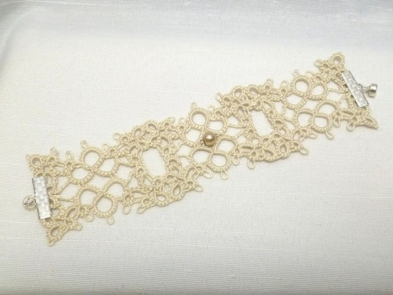 "Chantilly by SnappyTatter. 100% Egyptian cotton tatting cordonnet in Ecru for firm, uniform knots.  *A single glass pearl in light bronze between silver-lined glass beads accents the center  *jewelry components are Sterling Silver, the clasp is a strong magnet  *this version of Chantilly measures approximately 6 3/4"" long and 1 3/4"" wide and has a comfortable stretch."