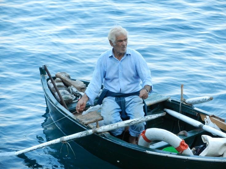 Man fishing near Positano, Italy