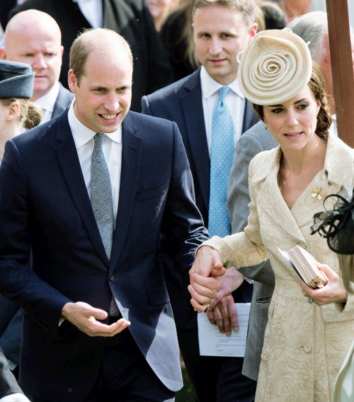 The Duke and Duchess of Cambridge hold hands as they attend the Secretary of State's annual Garden party at Hillsborough Castle on June 14, 2016 in Belfast, Northern Ireland.