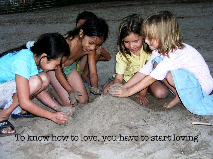 My kids on the sandy banks of a river in Laos. Showing love by building sand castles.