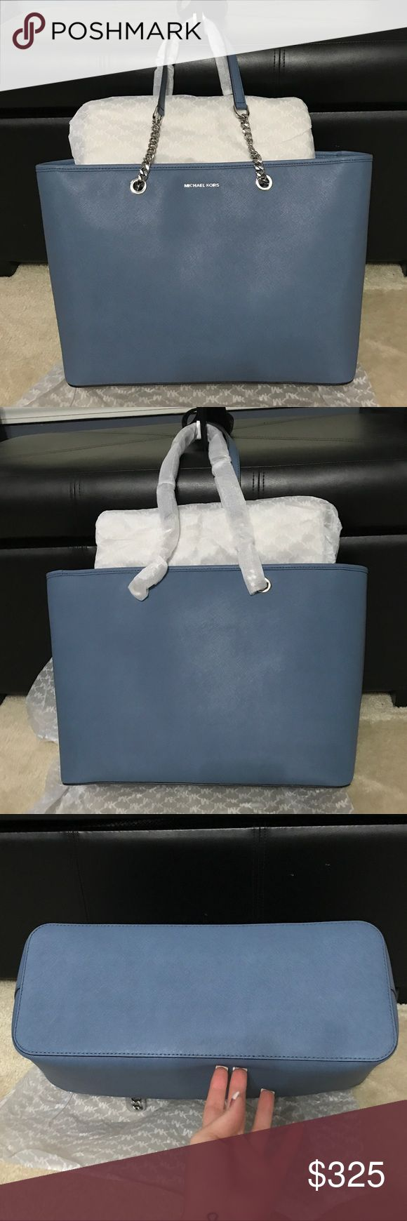"""NWT Michael Kors JetSet Multifunction Tote Brand new beautiful bag.  Color is Denim/Silver.  Photo 6 is the web description, however, I personally wouldn't consider this """"medium"""" - look at the measurements- it's a full sized tote!  To be clear, the color is Denim with Silver hardware, not black as the 2 stock photos show (#7 and #8).  Price firm 🖤 Michael Kors Bags"""