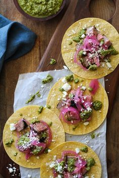 Coffee-Rubbed Grilled Tri-Tip Tacos with Chimichurri Sauce, cotija cheese, and pickled red onions