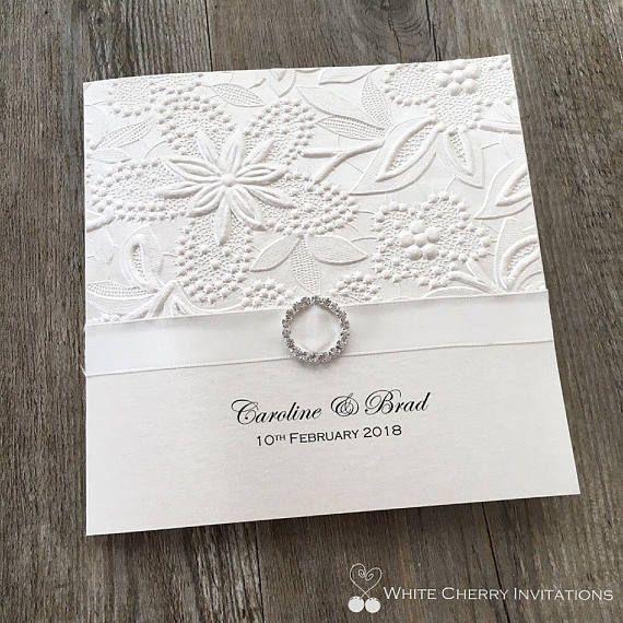 sample ivory embossed wedding invitation with diamante buckle - Embossed Wedding Invitations