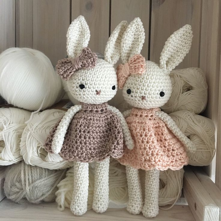 Little bunnies with different colors of the dresses