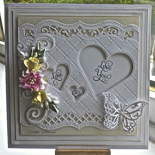 "Hi everyone, Todays card measures 7.5"" square so I have used Spellbinders grand squares as my base layers, the top layer I used SB bracket border 1, SB classic hearts, Sue Wilson heart lattice embo..."