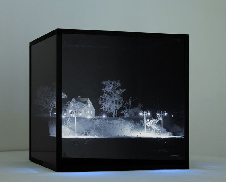 Dioramas where miniature street lamps illuminate real looking, eerie streets that lead to nowhere other than the edge of the box they're trapped in.