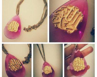 Translucent tear drop pendant with gold Arabesque design on golden multi-chain necklace