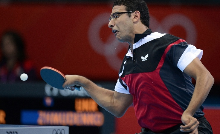 Egypt's Omar Assar returns a shot to Ukraine's Yaroslav Zhmudenko during a table tennis men's singles preliminary round match of the London 2012 Olympic Games at the Excel centre in London July 28, 2012. AFP Photo / Saeed Khan        (Photo credit should read SAEED KHAN/AFP/GettyImages)