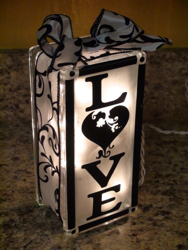 Made from a frosted glass block filled with lights (found at large craft stores like Hobby Lobby) and decorated with stickers or stencils and ribbon. Lovely! Daily update on my website: ediy3.com by PiaD