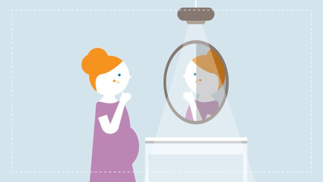 pregnant woman looking at acne