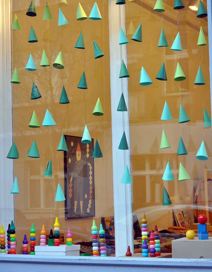 Neat idea for a hanging christmas tree garland. Maybe do gold polka dots all over for lights?