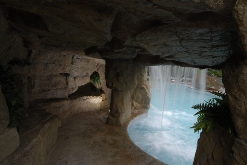 Enclosed Slide with Waterfalls tropical pool