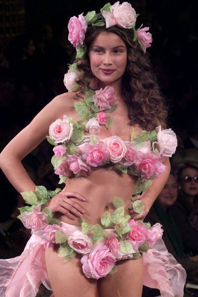 Top French model Laetitia Casta for French fashion designer Yves Saint Laurent presents this pink ro..