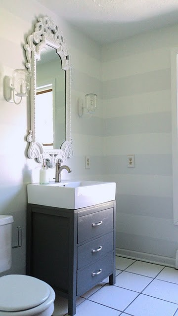 striped walls and fancy mirror