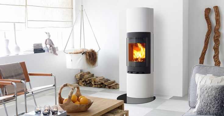 Jøtul FS 92 is a timeless fireplace in a slim and round shape designed by Eker Design.