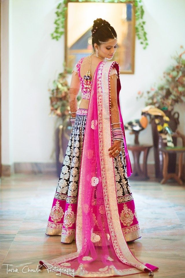 Fuchsia and royal blue. This is GORGEOUS. I LOVE India's wedding fashion, SO elegant and detailed. I think I would cry after I finished getting myself ready like the woman above when looking at myself in a mirror. Literally takes your breath away.