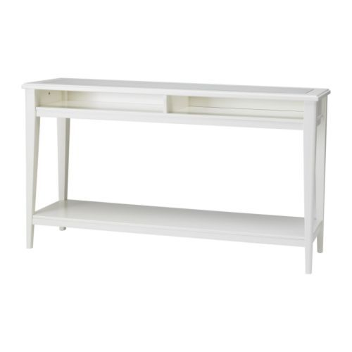 LIATORP Sofa Table from IKEA.  This is the perfect height for our sofa.  Great for displaying family pictures, and room for lots of books, plants or other decorative items along the bottom shelf.  Own it and love it!