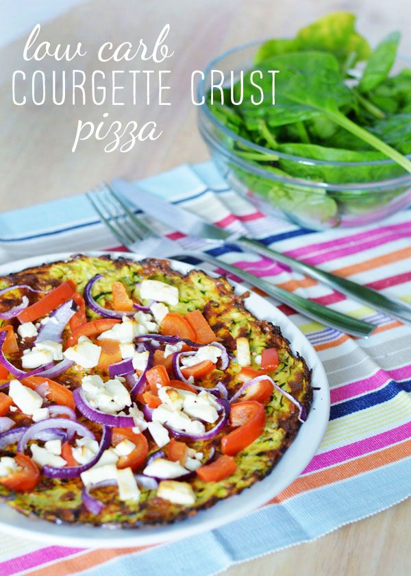 LOW CARB COURGETTE CRUST PIZZA 2 small or 1 and a half medium courgettes 1 medium egg 30g low fat cheese, grated  1/2 tsp Italian seasoning Toppings of choice - pesto, red onion, radish and feta cheese