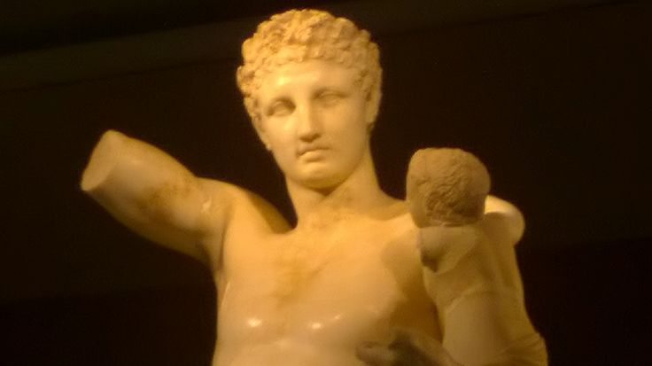 The statue of Hermes at the museum in Ancient Olympia shows a marble complex of the Hermes holiding the little Dionysus.