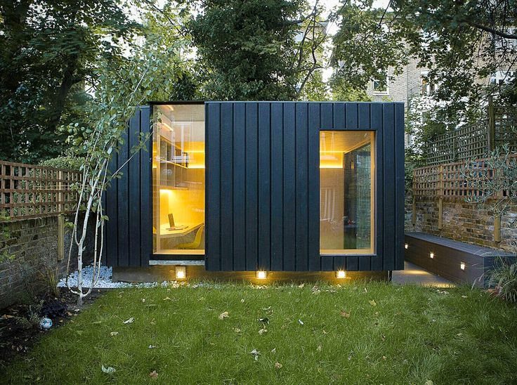 outside office shed. charred cedar clads this garden yoga studio and office by neil dusheiko in north london outside shed
