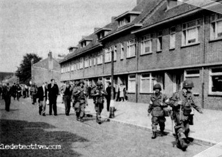 "Eindhoven, September 18th 1944  This picture is taken on Frankrijk Straat; just a few hundred yards South of the two German 88mm guns that ""F""-Co./506th destroyed on Klooster Dreef. In the photo we see Colonel Robert F. Sink, the Commanding Officer of the 506th Parachute Infantry Regiment, walking towards the center of Eindhoven."