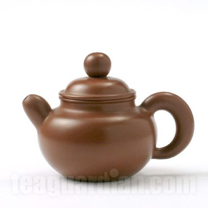 Yixing teapot in the traditional duoqiu design, modified with extra large lid bead and extra thick spout and handle. In very fine traditional zhuni Yixing clay. Artist: He Yen Ping, 2003