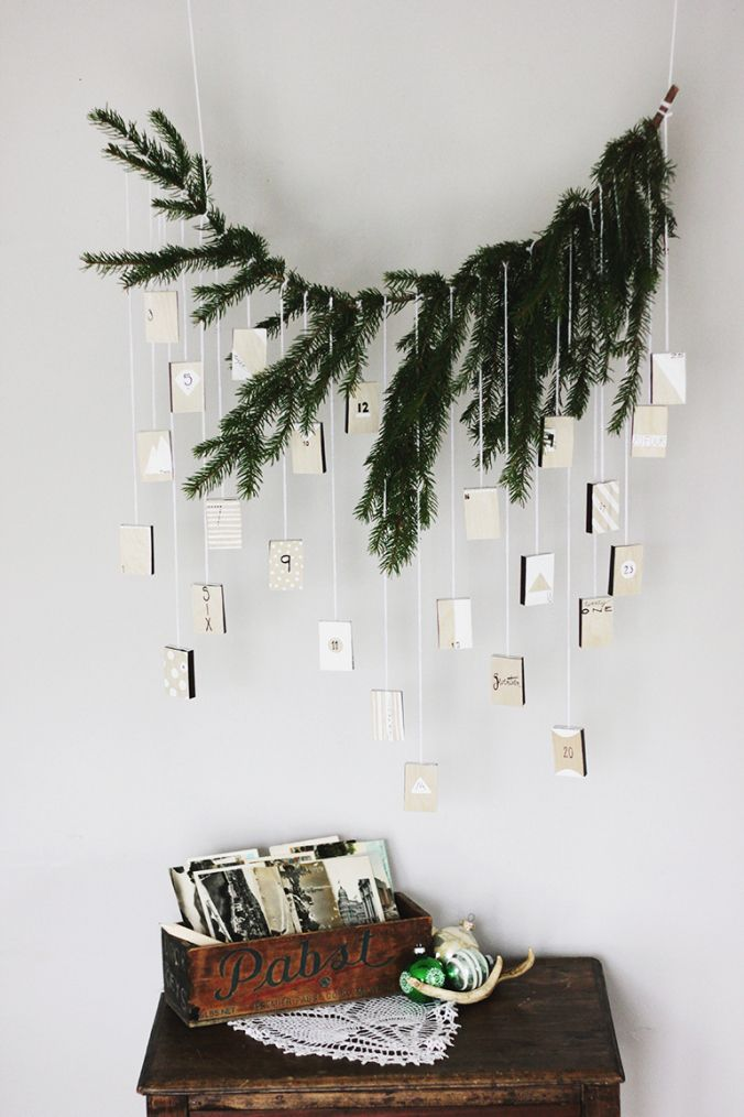 The Merry Thought - Evergreen Bough Hanging Advent Calendar via SCANDINAVIAN CHRISTMAS Advent Calendar round-up on the Oaxacaborn blog
