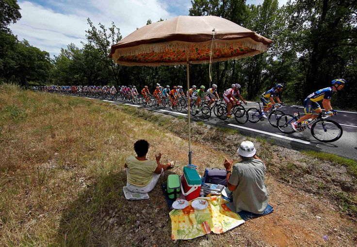 Fans picnic as the pack of riders cycles on its way during the 228.5 km fifth stage of the centenary Tour de France cycling race from Cagnes-Sur-Mer to Marseille on July 3. (Eric Gaillard/Reuters - See more at: http://www.boston.com/bigpicture/2013/07/tour_de_france_100th_edition_p.html#sthash.NBeqwlIC.dpuf