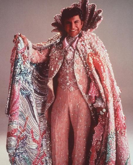 Liberace in King Neptune outfit, weighing 200 lbs