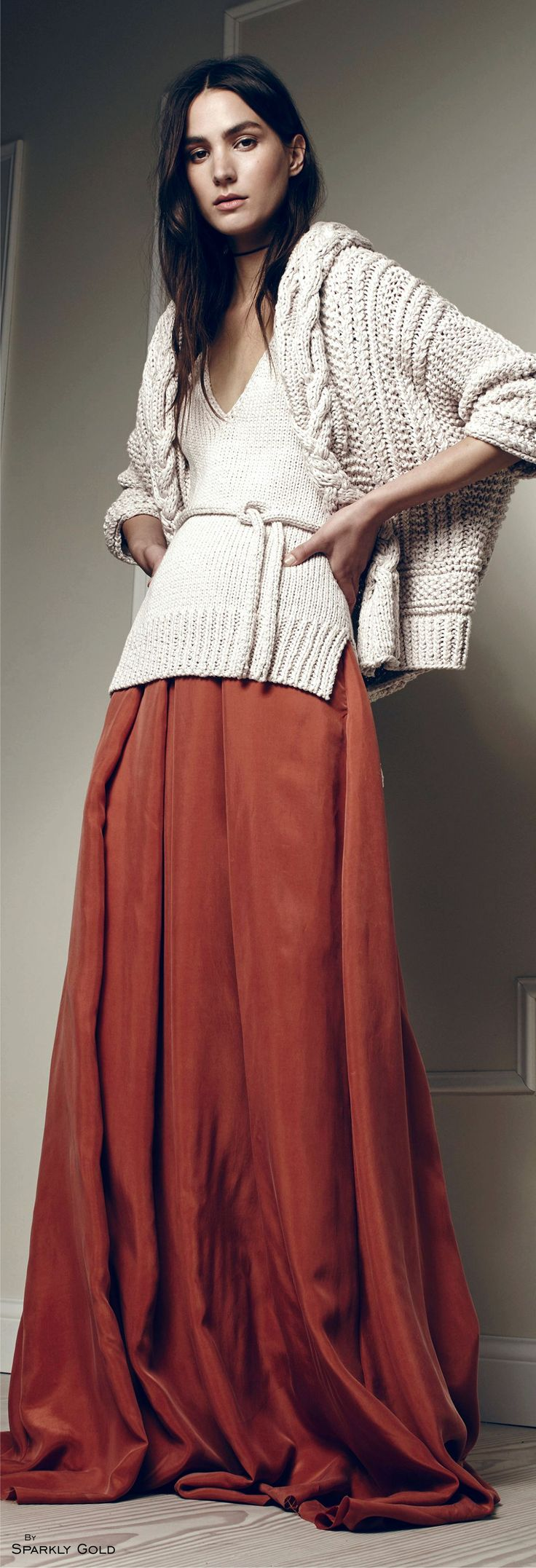 I have a Fisherman's cable knit sweater very similar to this, but no hood. Mine buttons down the front, and I love it!