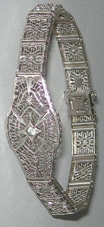 Sterling silver Art Deco filigree bracelet by JH Peckham. Via Diamonds in the Library.