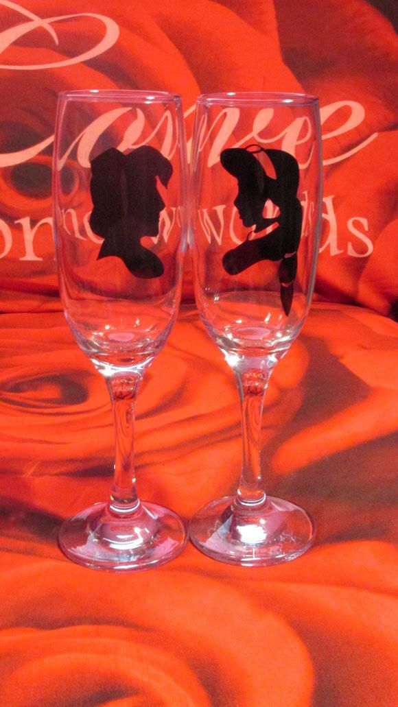 Disney Happily Ever After Aladdin and Jasmine Silhouette Champagne Glasses Personalised However You Want. Perfect For Wedding Favours. by ATouchOnGlass on Etsy https://www.etsy.com/listing/221166200/disney-happily-ever-after-aladdin-and