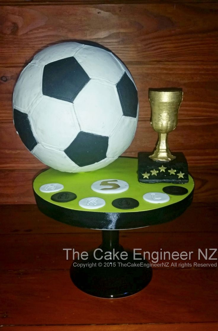 Football/Soccer cake with trophy