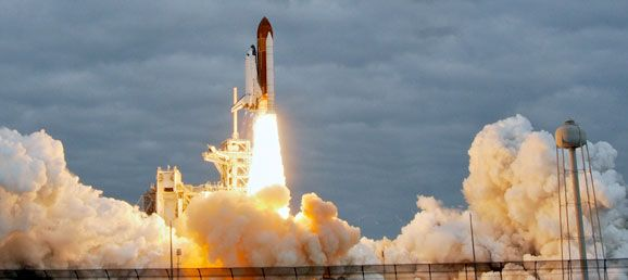 How Much Does The Paint On A Space Shuttle Weigh? -- Concept: Surface Area -- CCSS Standards: 6.G.4, 7.G.6, 8.G.7, G.MG.1, G.MG.3
