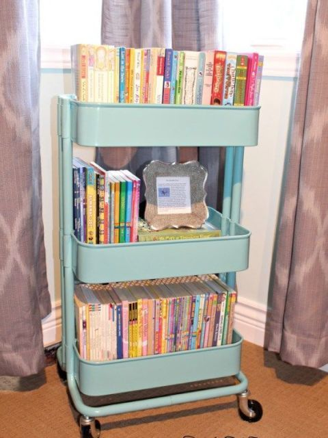 If we've said it once, we've said it a million times: IKEA's RASKOG Cart is super handy in every single room — and your kid's space is no exception. The baby blue color makes this an adorable, moveable book organizer. See more at Kylie M. Interiors »