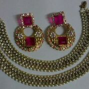 Traditional anklet with ruby earrings