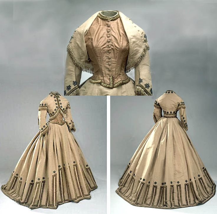 Zouave dress ca. early 1860s. Three pieces (bodice, skirt, bolero jacket). Jacket and skirt of light caramel brown silk faille with shirred white tulle trim on sleeves and velvet ribbon and lace motifs. Bodice of white canvas covered in front with brown taffeta; closes front with 11 buttons. Danish National Museum