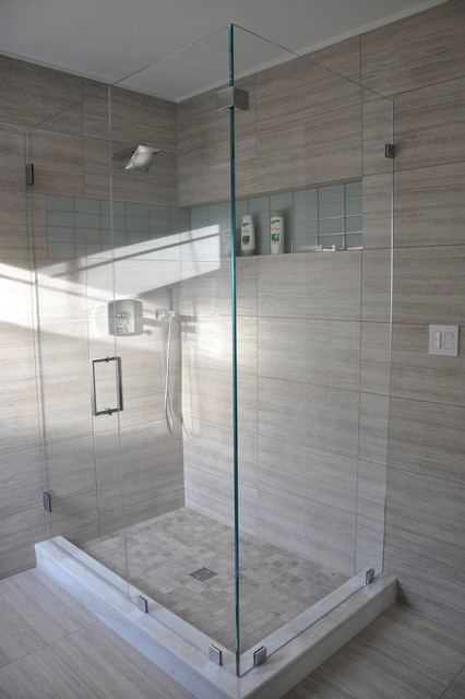 This stunning shower design showcases Seta glazed porcelain 12x24 tiles on the floor and walls in Beige. The shower floor also displays Silver Sand natural stone in a 2x2 mosaic.