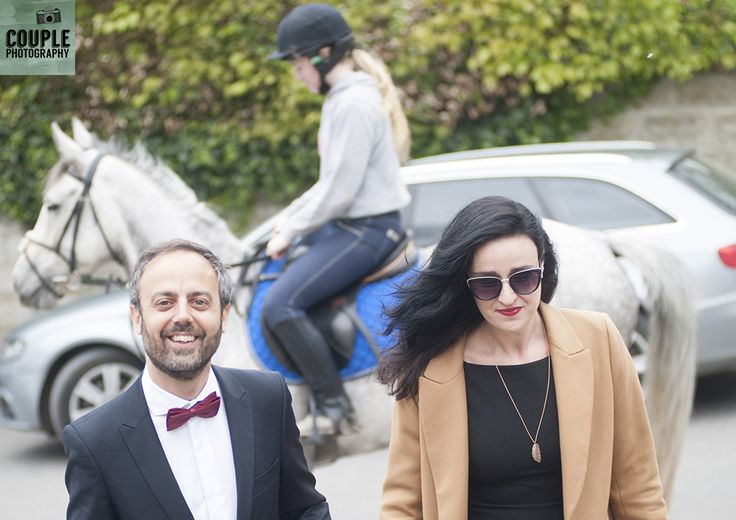 Guests arriving to the country chic wedding in Meath. Weddings at Ballymagarvey Village photographed by Couple Photography.